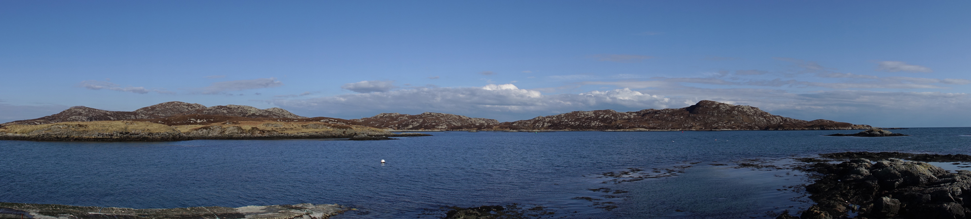 View past Kallin Harbour, Grimsey, North Uist.